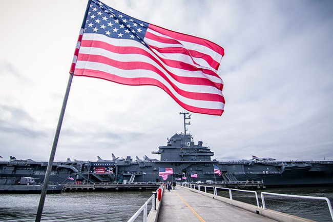 USS Yorktown with American Flag